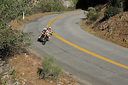 BMW F800GS riding corner in canyon in Mojave desert during 2009 Rawhyde Adventure Rider Challenge