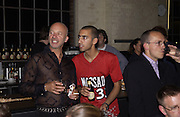 Nigel Coates and Payam sharifi. Buffalo and Pig. Fundraiser at the Wapping project. Wapping Hydrolic power station. 30 August 2001. © Copyright Photograph by Dafydd Jones 66 Stockwell Park Rd. London SW9 0DA Tel 020 7733 0108 www.dafjones.com