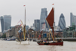 © Licensed to London News Pictures. 17/09/2016. LONDON, UK.  Sailing barges (Melissa and Niagara seen in front) parade on the River Thames, passing under Tower Bridge in London for the first ever Thames Sailing Barge Parade. The event aims to recreate scenes from Londonís days as a bustling trading port and the historic sailing barges taking part have not been seen together in one place since the industrial revolution.  Photo credit: Vickie Flores/LNP
