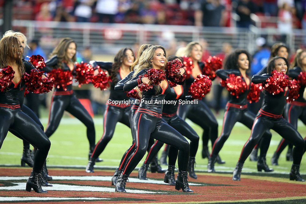 The San Francisco 49ers cheerleaders perform a dance routine before the 2015 NFL week 1 regular season football game against the Minnesota Vikings on Monday, Sept. 14, 2015 in Santa Clara, Calif. The 49ers won the game 20-3. (©Paul Anthony Spinelli)