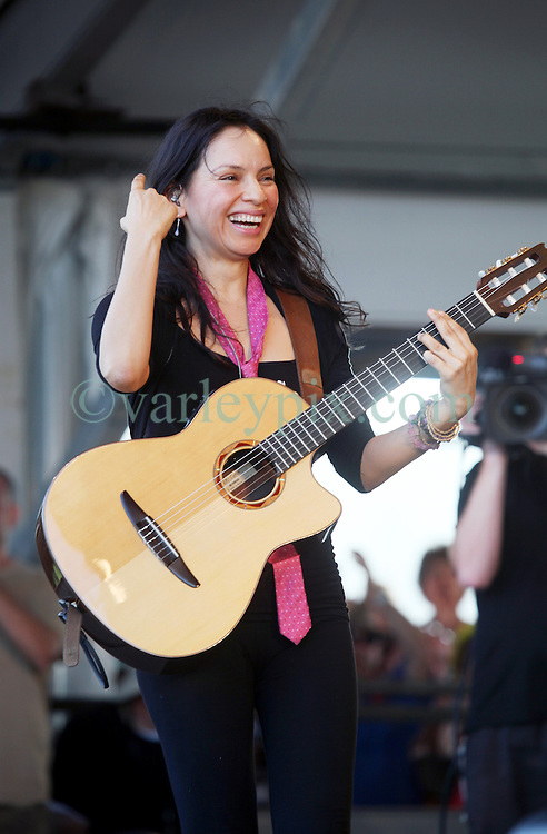 04 May 2012. New Orleans, Louisiana,  USA. .New Orleans Jazz and Heritage Festival. .Gabriela Quintero of the Mexican sensations 'Rodrigo and Gabriela' .Photo; Charlie Varley.