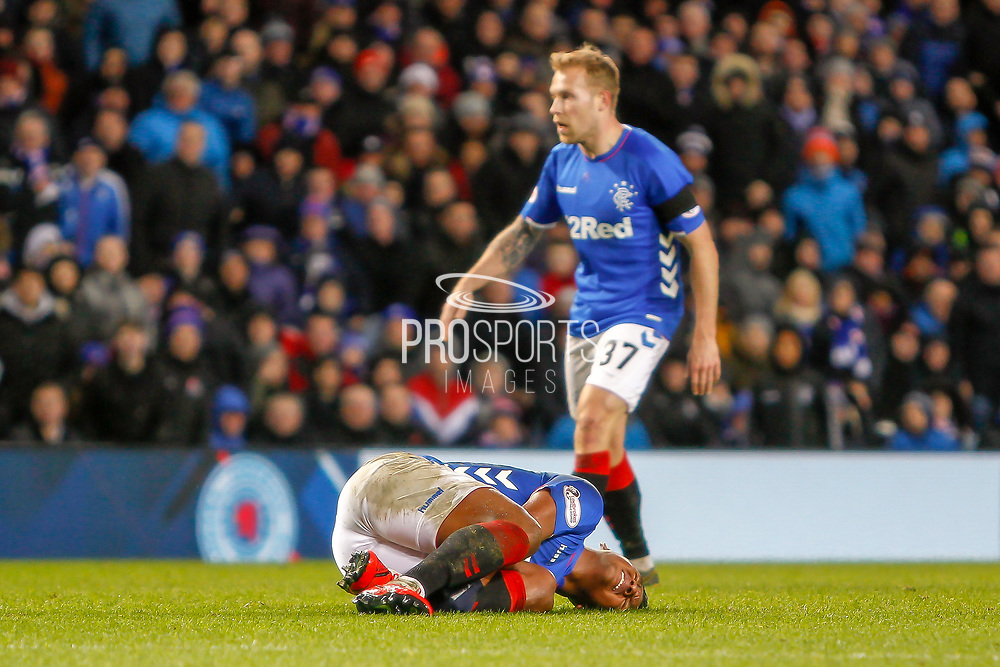 Alfredo Morelos of Rangers left in a heap during the William Hill Scottish Cup quarter final replay match between Rangers and Aberdeen at Ibrox, Glasgow, Scotland on 12 March 2019.