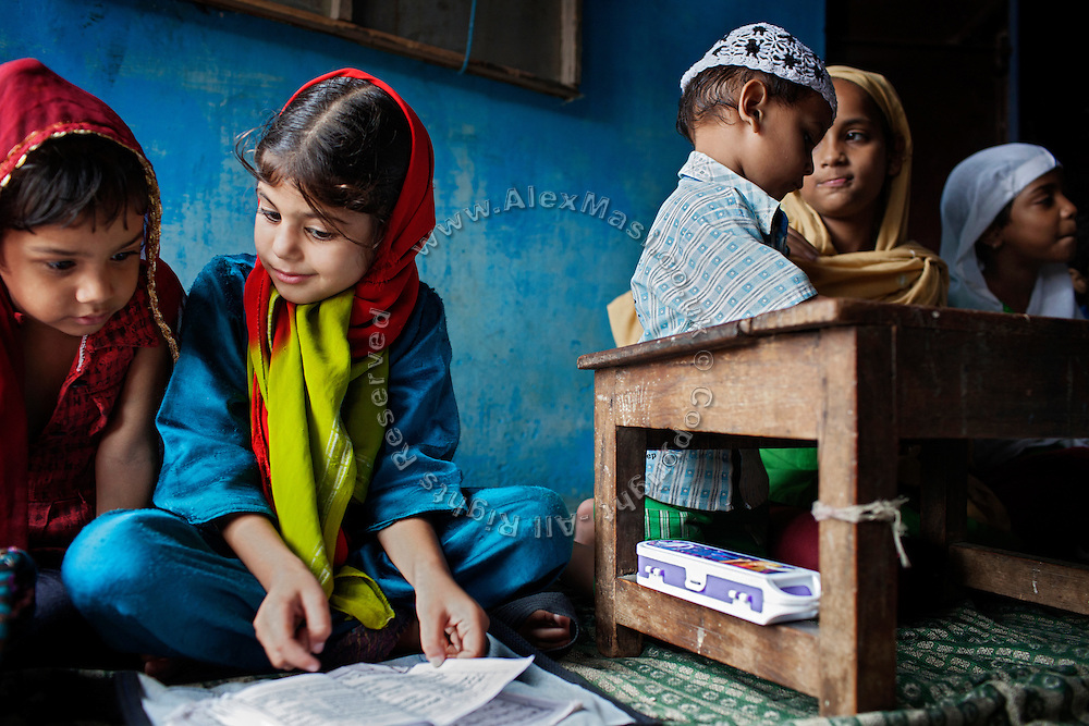 Muslim children are studying inside a small Madrassa (Islamic School) in Kasi Camp, one of the water-affected colonies of Bhopal, Madhya Pradesh, India, near the abandoned Union Carbide (now DOW Chemical) industrial complex, site of the infamous 1984 gas tragedy. The poisonous cloud that enveloped Bhopal left everlasting consequences that today continue to consume people's lives.