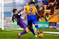 Mitchell Clark of Port Vale slides in to gain possession from Craig Davies of Mansfield Town - Mandatory by-line: Ryan Crockett/JMP - 17/11/2018 - FOOTBALL - One Call Stadium - Mansfield, England - Mansfield Town v Port Vale - Sky Bet League Two