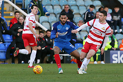 Alex Penny of Peterborough United closes down Tommy Rowe of Doncaster Rovers - Mandatory by-line: Joe Dent/JMP - 01/01/2018 - FOOTBALL - ABAX Stadium - Peterborough, England - Peterborough United v Doncaster Rovers - Sky Bet League One