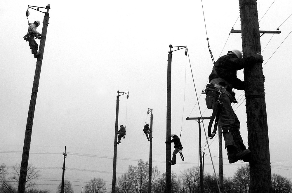 AEP workers go through training at practice poles in Lima, Ohio.
