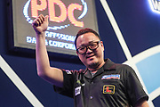 Seigo Asada wins his first round match against Micky Mansell during the PDC William Hill World Darts Championship at Alexandra Palace, London, United Kingdom on 17 December 2019.