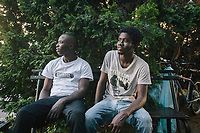 COMO, ITALY - 21 JUNE 2017: (L-R) Nigerian migrants Elahaj Mobou (19) and Mustafah Dejal (21), are seen nearby the abandoned parking garage where they sleep at night in Como, Italy, on June 21st 2017.<br /> <br /> Residents of Como are worried that funds redirected to migrants deprived the town's handicapped of services and complained that any protest prompted accusations of racism.<br /> <br /> Throughout Italy, run-off mayoral elections on Sunday will be considered bellwethers for upcoming national elections and immigration has again emerged as a burning issue.<br /> <br /> Italy has registered more than 70,000 migrants this year, 27 percent more than it did by this time in 2016, when a record 181,000 migrants arrived. Waves of migrants continue to make the perilous, and often fatal, crossing to southern Italy from Africa, South Asia and the Middle East, seeing Italy as the gateway to Europe.<br /> <br /> While migrants spoke of their appreciation of Italy's humanitarian efforts to save them from the Mediterranean Sea, they also expressed exhaustion with the country's intricate web of permits and papers and European rules that required them to stay in the country that first documented them.