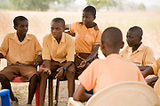 Members of a youth group discuss while sitting under a tree.Northern Ghana, Wednesday November 12, 2008.