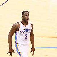 08 May 2016: Oklahoma City Thunder guard Dion Waiters (3) celebrates next to Oklahoma City Thunder forward Kevin Durant (35) during the Oklahoma City Thunder 111-97 victory over the San Antonio Spurs, during Game Four of the Western Conference Semifinals of the NBA Playoffs at the Chesapeake Energy Arena, Oklahoma City, Oklahoma, USA.