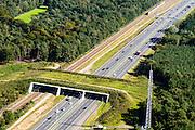 Nederland, Utrecht, Driebergen,  30-09-2015. Utrechtse Heuvelrug met ecoduct Mollebos over de A12 en de spoorlijn Utrecht-Arnhem tussen Driebergen en Maarn, ter hoogte van het dorp Austerlitz.<br /> Wildlife bridge over both motorway and railway in central Holland.<br /> luchtfoto (toeslag op standard tarieven);<br /> aerial photo (additional fee required);<br /> copyright foto/photo Siebe Swart