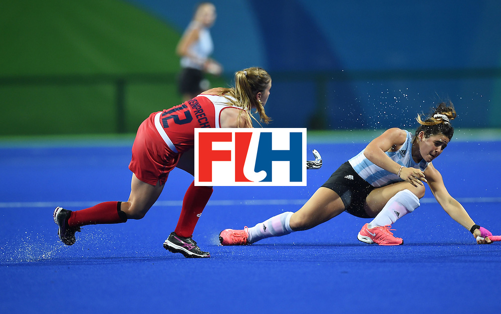 The USA's Julia Reinprecht hits the ball past Argentina's Maria Granatto during the women's field hockey Argentina vs USA match of the Rio 2016 Olympics Games at the Olympic Hockey Centre in Rio de Janeiro on August, 6 2016. / AFP / MANAN VATSYAYANA        (Photo credit should read MANAN VATSYAYANA/AFP/Getty Images)