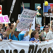 US Representative Jan Schakowsky (D-Ill) leads several thousand people marched asking President Donald J. Trump to release his income tax returns. Others protested against the President's anti-immigration policies. <br /> Photography by Jose More