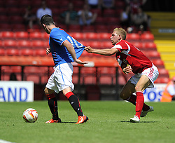Bristol City's Scott Wagstaff battles for the ball with Glasgow Rangers' Nicky Clark - Photo mandatory by-line: Joe Meredith/JMP - Tel: Mobile: 07966 386802 13/07/2013 - SPORT - FOOTBALL - Bristol -  Bristol City v Glasgow Rangers - Pre Season Friendly - Bristol - Ashton Gate Stadium