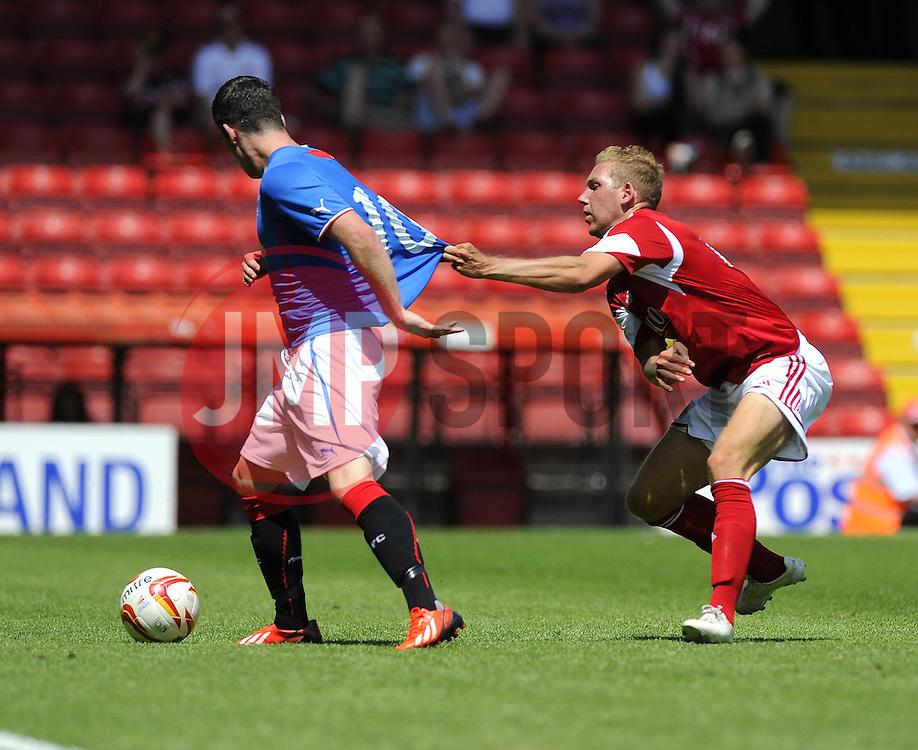 Bristol City's Scott Wagstaff battles for the ball with Glasgow Rangers' Nicky Clark - Photo mandatory by-line: Joe Meredith/JMP - Tel: Mobile: 07966 386802 13/07/2013 - SPORT - FOOTBALL - Bristol -  Bristol City v Glasgow Rangers - Pre Season Friendly - Bristol - Ashton Gate Stadium