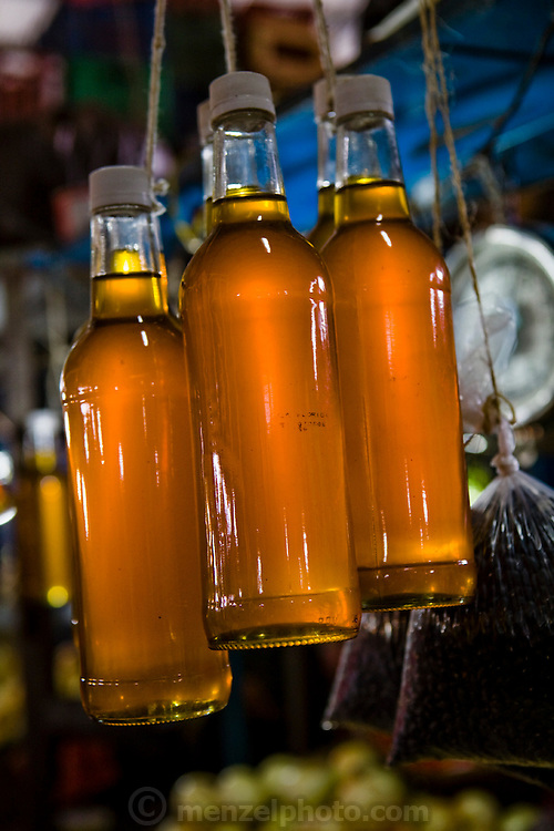 Bottles of honey for sale at Mercado Quinta Crespo, Caracas, Venezuela.