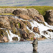 Tómas guðmundsson fly fishing at the pool Efri Beljandi on the river Breiðdalsá, Iceland.