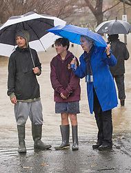 MP Nicky Wagner speaks with locals on Ford Road after flooding from the Heathcote River, Christchurch, New Zealand, Saturday, July 22, 2017. Credit:  SNPA / David Alexander -NO ARCHIVING-