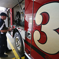 Saltillo Fire Department Captain Jamie Thomas, checks the oxygen tanks on board the fire truck as part of the departments daily check list.