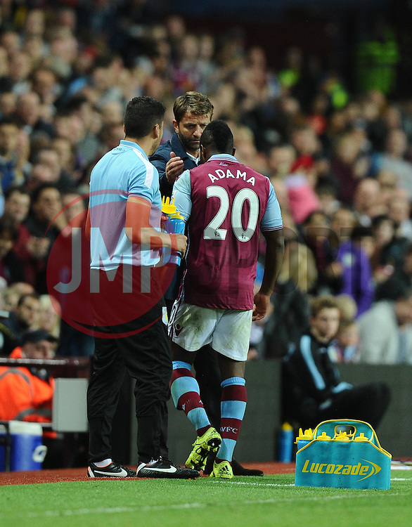 Aston Villa Manager Tim Sherwood comforts Adama Traore of Aston Villa as he ls replaced due to injury  - Mandatory byline: Joe Meredith/JMP - 07966386802 - 25/08/2015 - FOOTBALL - Villa Park -Birmingham,England - Aston Villa v Notts County - Capital One Cup - Second Round