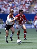 FIFA World Cup - USA 1994<br /> 10.7.1994, Giants Stadium, New York/New Jersey.<br /> World Cup Quarter Final, Bulgaria v Germany.<br /> Thomas Helmer (Germany) v Emil Kostadinov (Bulgaria).