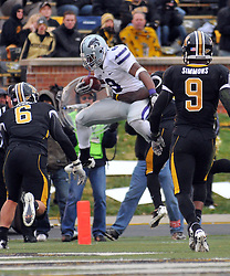 Nov 13, 2010; Columbia, MO, USA; Kansas State Wildcats running back Daniel Thomas (8) leaps in for a touchdown as Missouri Tigers safety Kenji Jackson (13) attempts the tackle in the second half at Memorial Stadium. Missouri won 38-28.  Mandatory Credit: Denny Medley-US PRESSWIRE