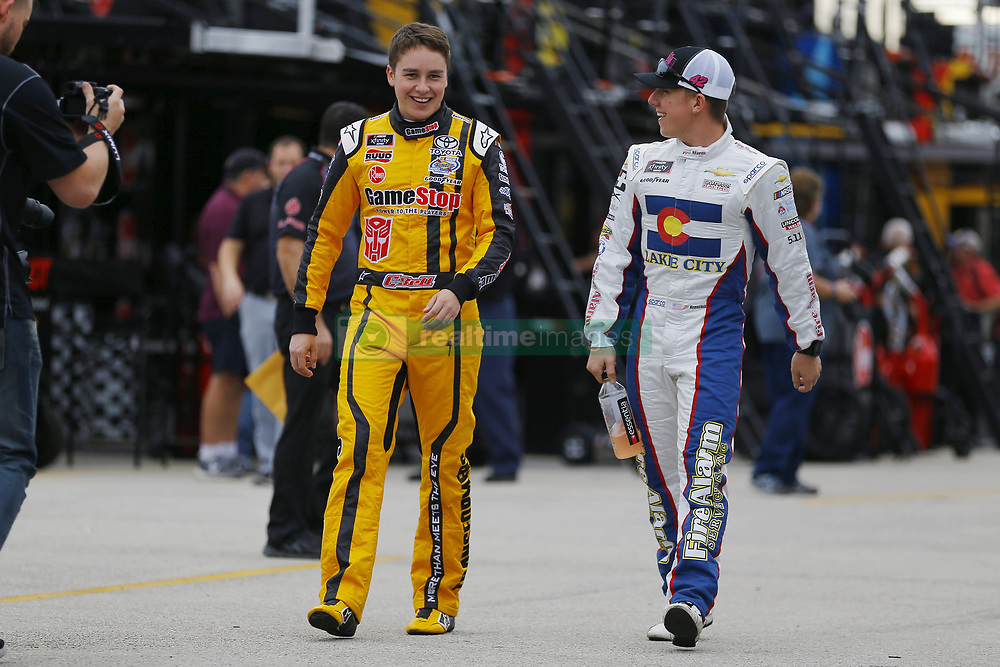 November 16, 2018 - Homestead, Florida, U.S. - Christopher Bell (20) and Kyle Larson (42) hang out in the garage during practice for the Ford 300 at Homestead-Miami Speedway in Homestead, Florida. (Credit Image: © Chris Owens Asp Inc/ASP)
