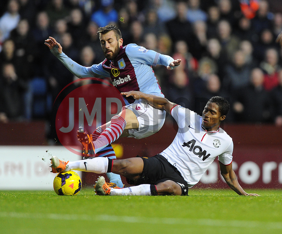 Manchester United's Luis Antonio Valencia tackles Aston Villa's Antonio Luna - Photo mandatory by-line: Joe Meredith/JMP - Tel: Mobile: 07966 386802 15/12/2013 - SPORT - Football - Birmingham - Villa Park - Aston Villa v Manchester United - Barclays Premier League
