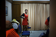 YANGON,MYANMAR,MARCH 2012: Cha Cha in the dressing room of the Traders Hotel in central Yangon right before the concert.<br /> Burma is a country in Transition. And if that hasn't been made clear enough by the political debates and the recent by-elections, meet the Me N Ma Girls, the first girlband in the country.<br /> The timing couldn't be better. After the April 1st elections in 2012 an always increasing number of investors from all over the world has been visiting Myanmar. After decades of military regime and isolation, the strings of censorship have started loosening up. The government censors in fact for years have banned songs and articles, deleting anything that was seen as &quot;to provocative&quot; such as leather outfits and colored wigs.<br /> Describing themselves as Myanmar's first all-girl group, under the management of the Australian dancer and choreographer Nicole May, these five women - coming from either Buddhist or Catholic background and formerly known as Tiger Girls - not only have been challenging censorship laws but they're as well trying to win hearts in a society that in many ways remains man-dominated and socially conservative.<br /> In a country that has been locked up for years, the Me N Ma Girls, embracing western pop culture with skimpy outfits and catchy songs, show with every performance the will of the Burmese youth to come out of a decades-long isolation.<br /> Five girls leading a new form of rebellion: the kind that questions roles and cultural norms.