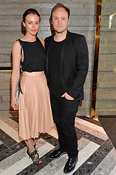 KATIE BAIN and NICHOLAS KIRKWOOD at the opening of Roksanda - the new Mayfair Store for designer Roksanda Ilincic at 9 Mount Street, London on 10th June 2014.