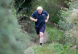© Licensed to London News Pictures. 11/09/2018. Thame, UK. Boris Johnson returns from a morning run at his Oxfordshire house . Last week it was announced that Boris Johnson and his wife Marina Wheeler are getting divorced. Photo credit: Peter Macdiarmid/LNP