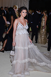 Selena Gomez walking the red carpet at The Metropolitan Museum of Art Costume Institute Benefit celebrating the opening of Heavenly Bodies : Fashion and the Catholic Imagination held at The Metropolitan Museum of Art  in New York, NY, on May 7, 2018. (Photo by Anthony Behar/Sipa USA)