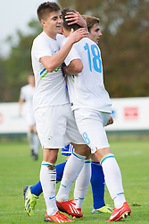 Jan Andrejasic and other players of Slovenia celebrate during football game between Slovenia and Andorra of UEFA Under19 Championship Qualifications, on October 15, 2013 in Bakovci, Slovenia. (Photo by Erik Kavas / Sportida)