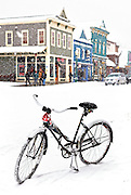"SHOT 2/12/12 11:18:54 AM - A snow covered cruiser bike on Elk Avenue in Crested Butte, Co. Crested Butte is a Home Rule Municipality in Gunnison County, Colorado, United States. A former coal mining town now called ""the last great Colorado ski town"", Crested Butte is a destination for skiing, mountain biking, and a variety of other outdoor activities. The population was 1,529 at the 2000 census. The Colorado General Assembly has designated Crested Butte the wildflower capital of Colorado. The primary winter activity in Crested Butte is skiing or snowboarding at nearby Crested Butte Mountain Resort in Mount Crested Butte, Colorado. Backcountry skiing in the surrounding mountains is some of the best in Colorado. The mountain, Crested Butte, rises to 12,162 feet (3,700 m) above sea level..(Photo by Marc Piscotty / © 2012)"