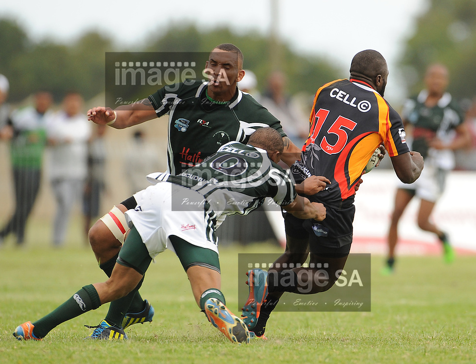 GEORGE, SOUTH AFRICA - Saturday 7 March 2015, Lluwellyn Treurnicht of Pacaltsdorp Evergreens and Leegan Moos of Pacaltsdorp Evergreens tackles Menzi Ngidi of Vaseline Wanderers during the third round match of the Cell C Community Cup between Pacaltsdorp Evergreens and Vaseline Wanderers at Pacaltsdorp Sports Grounds, George<br /> Photo by Roger Sedres/ImageSA/ SARU