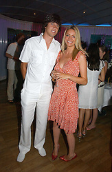TV presenters TESS DALY and VERNON KAY at a party to celebrate the publication of 'How to Party' by Yasmin Mills with illustrations by Olympia Scarry, held at the Fifth Floor Restaurant, Harvey Nichols, Knightsbridge, London on 3rd July 2006.<br /><br />NON EXCLUSIVE - WORLD RIGHTS