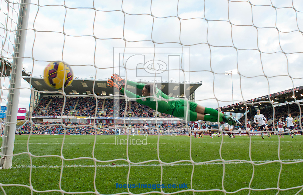 A shot by Samuel Eto'o of Everton beats Burnley goalkeeper Thomas Heaton to make it 3-1 during the Barclays Premier League match at Turf Moor, Burnley<br /> Picture by Russell Hart/Focus Images Ltd 07791 688 420<br /> 26/10/2014