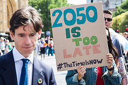 London, UK. 26 June, 2019. Rory Stewart, Conservative MP for Penrith and The Border, passes climate change activists during a mass lobby of Parliament for the climate and environment.
