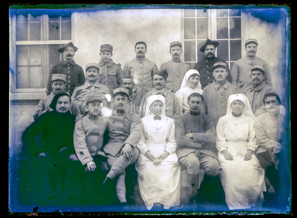 group portrait French soldiers with nurses ca 1910s