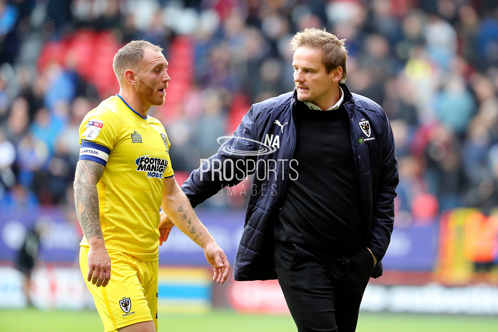 AFC Wimbledon manager Neal Ardley with AFC Wimbledon defender Barry Fuller (2) during the EFL Sky Bet League 1 match between Charlton Athletic and AFC Wimbledon at The Valley, London, England on 28 October 2017. Photo by Matthew Redman.