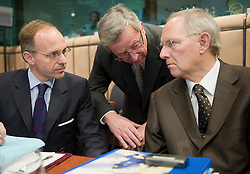 Jean-Claude Juncker, Luxembourg's prime minister, and president of the Eurogroup, center, speaks with Luc Frieden, Luxembourg's finance minister, left, and Wolfgang Schaeuble, Germany's finance minister, right, during the meeting of European Union finance ministers in Brussels, Belgium, on Monday, May 17, 2010. (Photo © Jock Fistick)
