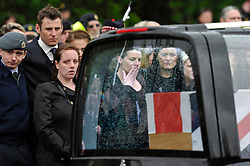 © Licensed to London News Pictures. 9th May 2013. Carterton.  .Lyndsey Savage pregnant wife of CPL Savage. REPATRIATION of Cpl William Savage and Fusilier Samuel Flint from the Royal Highland Fusiliers, the 2nd Battalion The Royal Regiment Of Scotland and Pte Robert Hetherington, of the 51st Highland, 7th Battalion - a Territorial Army member..Their Mastiff armoured vehicle was hit by a roadside device during a routine patrol in Helmand on 30 April.. Photo credit : MarkHemsworth/LNP