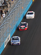 Nov. 12 2011; Avondale, AZ, USA; NASCAR Nationwide Series driver Aric Almirola (88) leads Clint Bowyer (33) and Ricky Stenhouse Jr. (6) during the Wypall 200 at Phoenix International Raceway. Mandatory Credit: Jennifer Stewart-US PRESSWIRE