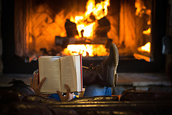 Settling in to a good book in front of the fire at Evergreen Lodge, Yosemite, CA