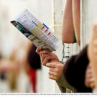 27 July 2004; A fan checks his race card during the McDonagh Feeds EBF Fillies Maiden. Galway Races, Ballybrit, Co. Galway. Picture credit; Pat Murphy / SPORTSFILE