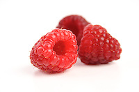 Close-up of raspberries on wite background