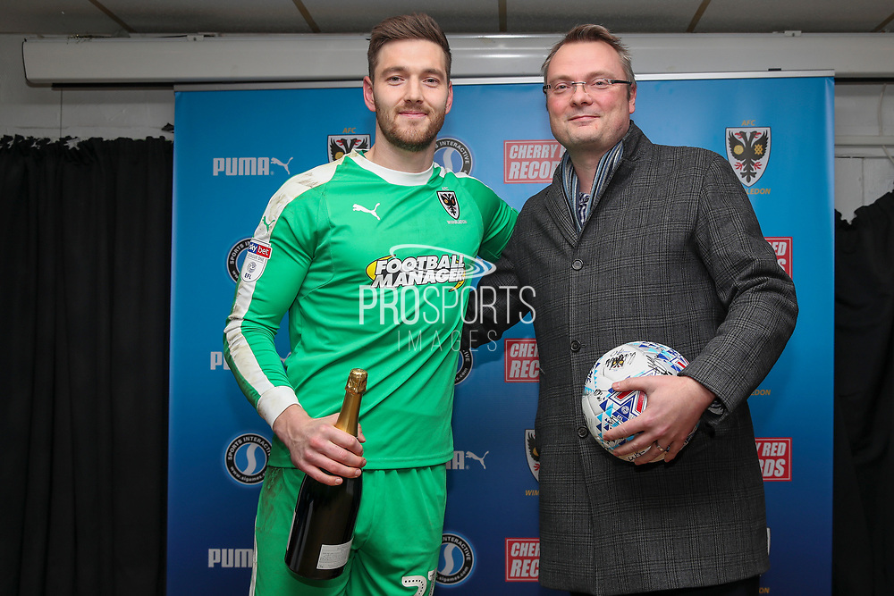 AFC Wimbledon goalkeeper Joe Day (21) receiving man of match award during the EFL Sky Bet League 1 match between AFC Wimbledon and Ipswich Town at the Cherry Red Records Stadium, Kingston, England on 11 February 2020.