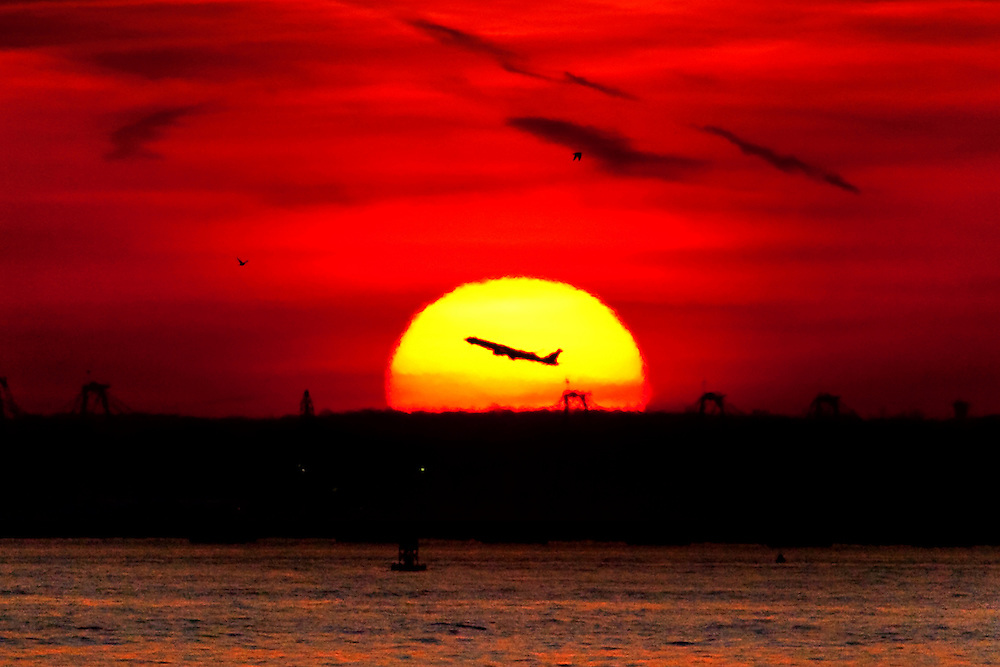 Jet plane taking off from Newark International Airport in New Jersey as seen from Brooklyn. 2010
