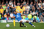 Mansfield Town defender Hayden White (16) and Chesterfield midfielder Zavon Hines (41) battle for the ball during the EFL Sky Bet League 2 match between Chesterfield and Mansfield Town at the Proact stadium, Chesterfield, England on 14 A pril 2018. Picture by Nigel Cole.