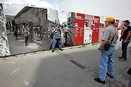 GERMANY - BERLIN - American tourists on a spot where the Berlin Wall used to be near Checkpoint Charlie. PHOTO  GERRIT DE HEUS